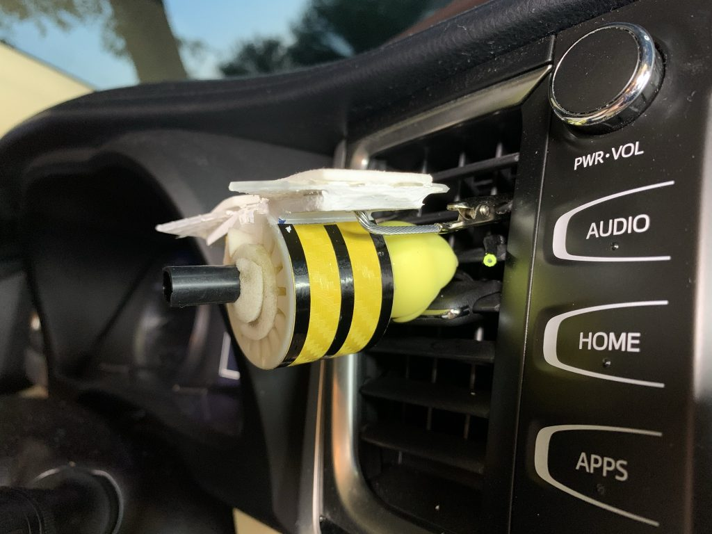 Bee attached to vent